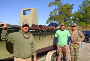 Bryan DeHart, Travis Horne, and Danny Graham after a morning of hunting.